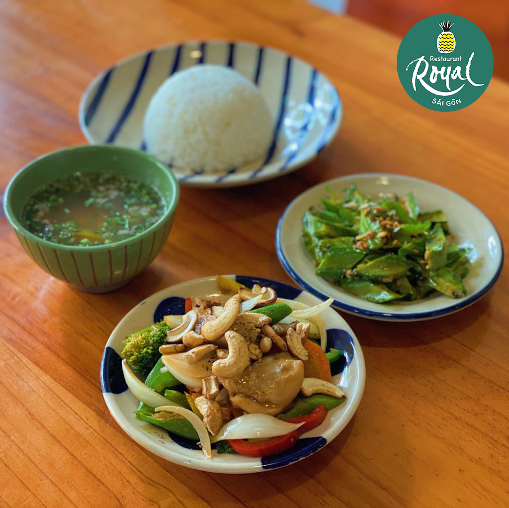 Set lunch 50k VND  Chicken cashew nuts, with sauteed dragon beans and pumpkin soup and white rice.